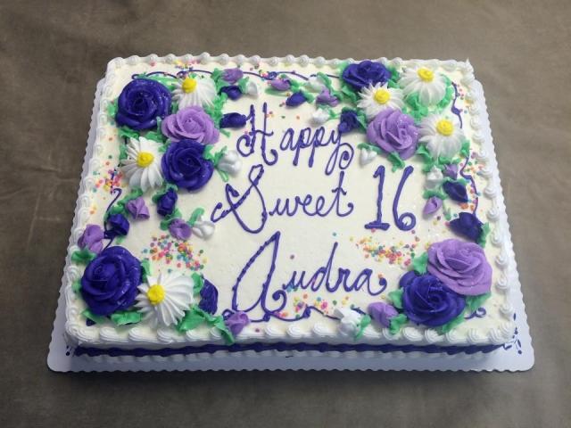 ROSES DAISIES ON HALF SHEET CAKE