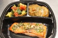 Seared Salmon with a Citrus Dill Sauce, Roasted Garlic Smashed Potatoes, and Zucchini with Tomatoes Oreganato