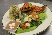 Grilled Chicken Breast Topped with a Strawberry Salsa Accompanied by a Fresh Garden Salad, & a Vegetable Rice Pilaf Tower